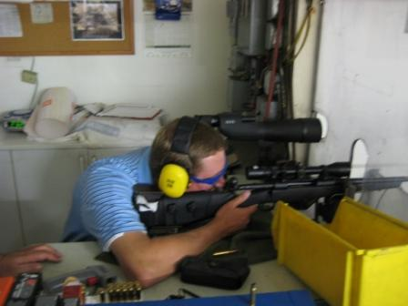 Guy checks to see if he can hit the paper. All kidding aside, they really know how to make guns. All of our guns shot a 1 inch group with in 5 shells. Not bad considering we built them.